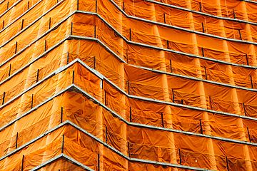 Orange scaffolding on building.