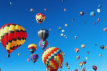 Blue sky full of colorful hot-air balloons