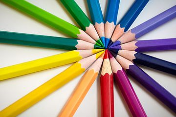 Colored pencils in a circle, tips pointing inward.
