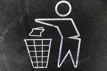 Close up of a recycle garbage bin logo