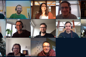 Screenshot of an online meeting with 13 participants.